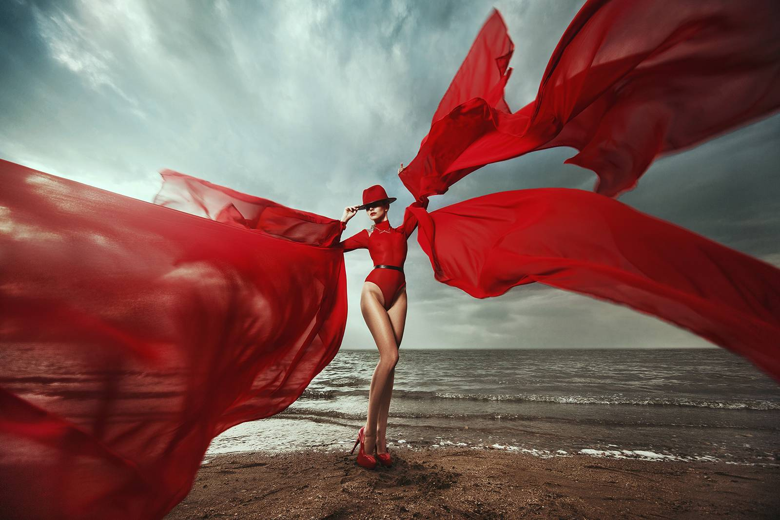 Woman dressed in red bodysuit with red cloth wings made at MIMO Space atelier